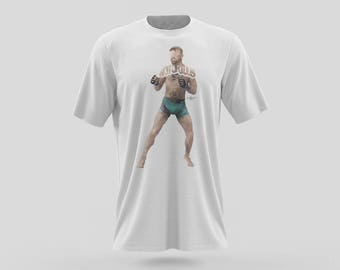 Conor McGregor T-Shirt Typography Design of Him In His Uniform Getting Ready to Fight. The Notorious Irish Mixed Martial Artist on T-Shirt
