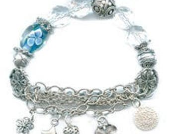 Blue glass and metal charm bracelet