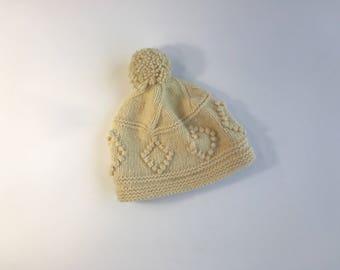 White crochet pom pom hat