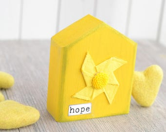 Yellow HOPE House Sign.