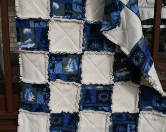 RAG fleece Quilt. Blue and White. 2 layers of Fleece. 5 by 7 Squares. Designed by Judy