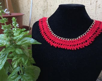 Red cotton necklace on gold chain