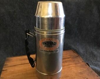 Cool industrial vintage Uno-Vac thermos