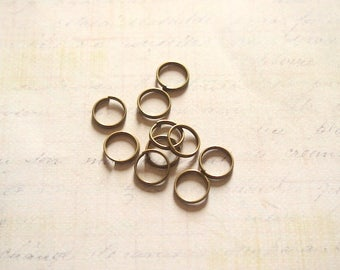 10 rings double twist metal color bronze 12mm