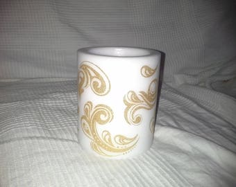 white round candle with pattern