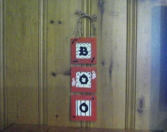Cute Halloween BOO Sign in Orange, Black, and Cream Wall Decor with Bats, Ghosts and Spiders a Wire Hanger and Jute Twine Bow.