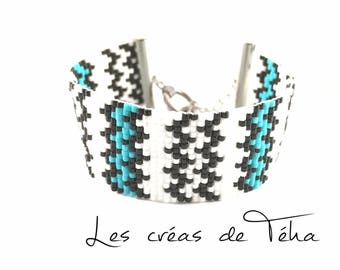 Very nice black, white and blue bracelet woven with miyuki beads