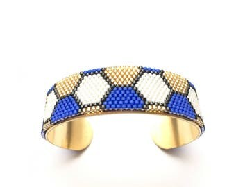 Very nice bracelet black and white, blue and gold woven miyuki mounted on rigid bracelet