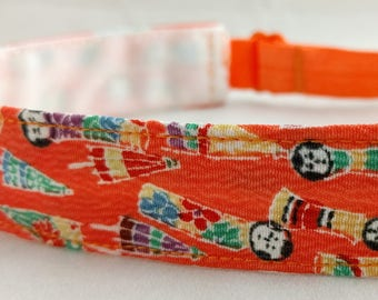 Adjustable non-slip Headband hairband made with vintage silk kimono fabric - orange kokeshi doll