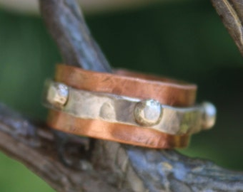 Bumpy Road - a copper and sterling silver ring.