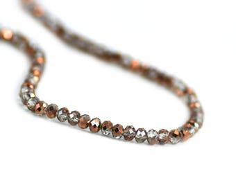Chinese Crystal Tiny Rondelles Beads in Clear Transparent with Copper Rose Gold Finish 2x3mm