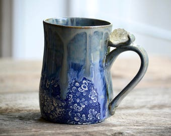 Large handmade pottery mug with blue flowers and citrine crystal on handle