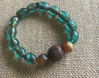Glass teal beads and lava stone essential oil diffuser bracelet