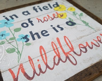In a field of roses she is a WILDFLOWER wood sign, Nursery Room Sign, Baby Girl, Rustic Sign, Baby Gift Sign, Baby Room Decor, Wildflower