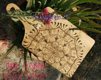 Mandala pyrography on a bamboo cutting board