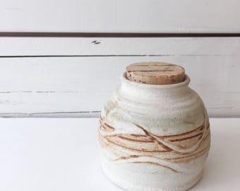 Vintage ceramic jar with cork