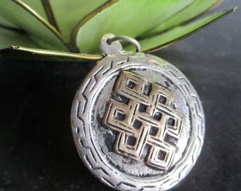 Endless knot pendant double sided.