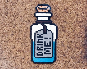 alice in wonderland drink me perler kandi necklace magnet canvas