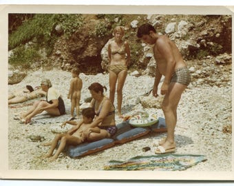Old snapshot, vintage photo, little boy with parents skinny dipping on beach, 1970's European child photo, swimming beachwear summer holiday