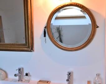 Miroir doré rond