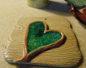 Handmade pottery wall plaque with turquoise heart