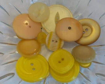 Assortment of Yellow Plastic Buttons