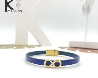 Infinity leather bracelet blue and gold metal