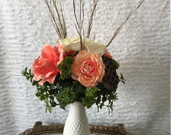 Artificial Floral Arrangement with Roses, Ranunculus, Lotus Pods and Greenery in a Cream Dimpled Vase