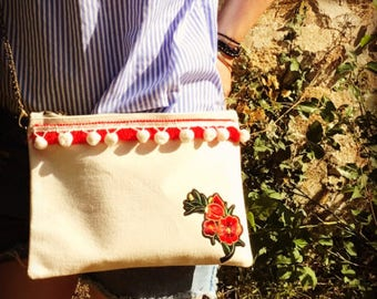 Embroidered flower clutch, fringe and tassel