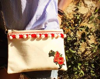 REJANE embroidered flower clutch, fringe and tassel