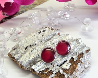 Silver-plated stud earrings with dark red cabochons