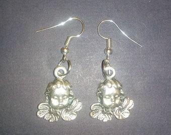 Metal earrings. Angels