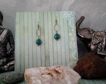 A pair of earrings in bronze and turquoise beads from India