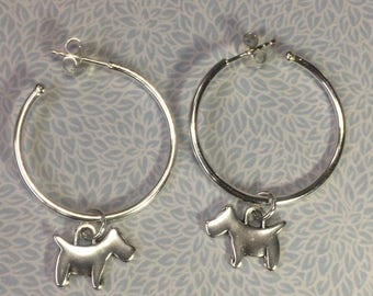 Sterling silver hoop earrings with cute dog charm attached