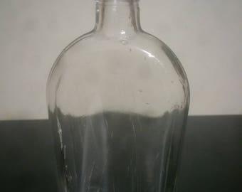 Large antique oil bottle