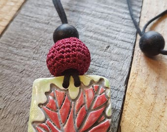 Maple Leaf Ceramic Pendant, large crochet bead, up cycled black rubber bead. Handmade, one of a kind.