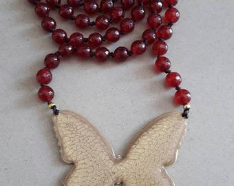 Butterfly made of brass colored with cold enamel in gold color