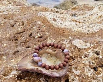 Purple Hawaiian cowrie shell bracelet