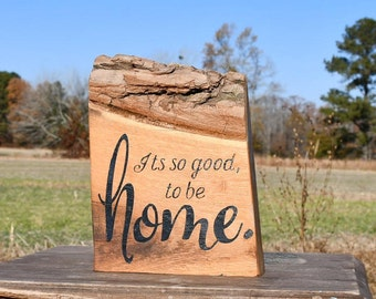 Live edge 'It's so good to be home' painted wooden sign