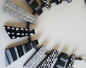 A unique black and white necklace in polymer clay
