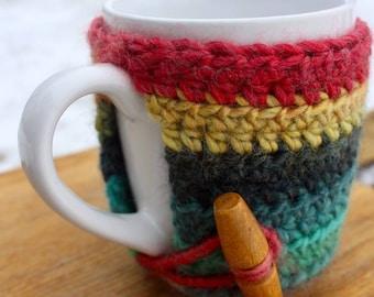 Mug with yellow, blue cosy woollen crochet jumper