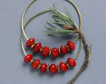 large hammered brass hoops with exotic red seeds - African statement earrings - natural ethnic jewelry