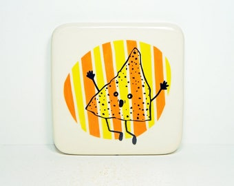 tile with an overly enthusiastic nacho chip on a somewhat stripey background of orange & yellow. Made to Order.