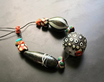 Lori Lochner Designs Handmade lampwork blown glass bead Sra artisan jewelry making supply tribal rustic black white and red