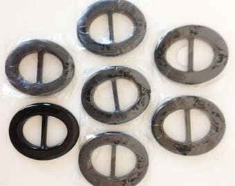 "3"" plastic black belt buckles, set of seven"