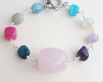 Colorful bracelet. Pink rose quartz and colored glass beads bracelet
