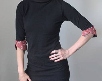 mock turtleneck/half sleeved tunic dress/petal cuffs/black with rose pink feather print