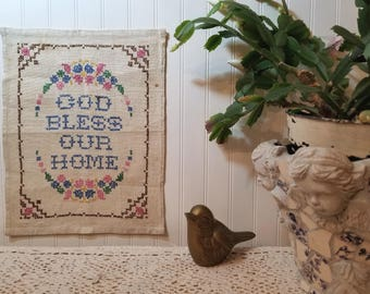 Vintage 'God Bless Our Home' Cross Stitch. Floral Cottage Farmhouse wall decor. Flowers, border. Hand stitched needlework, embroidery.