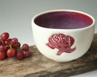 Handmade ceramic bowl with bold red waratah flower