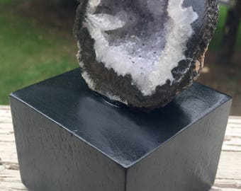Decorative geode mounted to wood